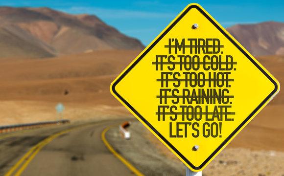 Lets Go! sign on desert road