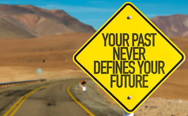 Your Past Never Defines Your Future sign on desert road Wall mural