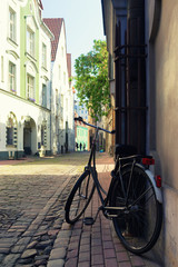 Bicycle parked on the street in the old town of Riga