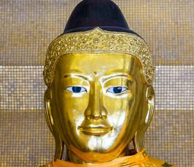 Kakusandha buddha image covered with foilgold