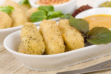 Deep Fried Cheese - Breaded and deep fried cheese served with dipping sauce.