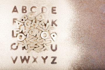 Gold English alphabet on a gold background