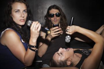 Friends doing karaoke at a nightclub