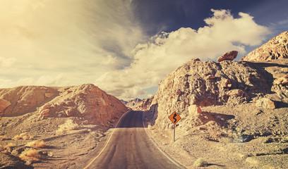 Old film retro stylized rocky desert road, USA.
