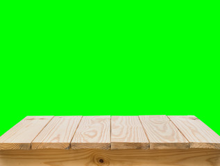 Wood table with green screen background