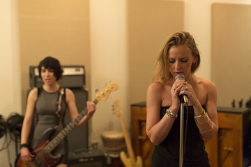 Young musicians practicing at a rehearsal space