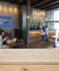 Wood table with blur coffee shop background