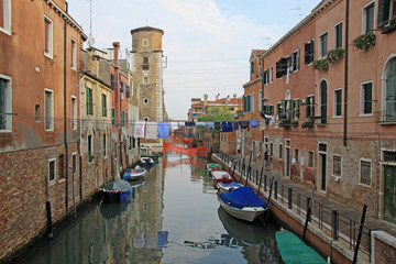 VENICE, ITALY - SEPTEMBER 04, 2012:  Rio de Sant'Ana in sestiere Castello with boats and colorful facades of old medieval houses in Venice, Italy