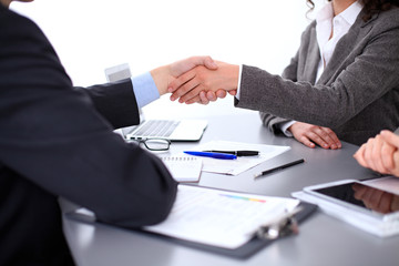 Business people shaking hands, finishing up a meeting, copy spase area