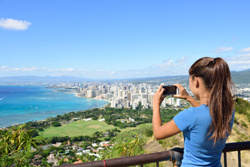 Hawaii tourist taking photo Honolulu Waikiki beach