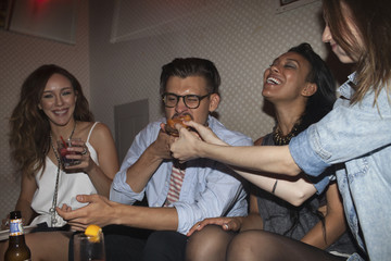 Friends hanging out at a party