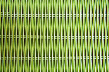 Green wicker texture. Crafts, outdoor furniture and abstract background concept