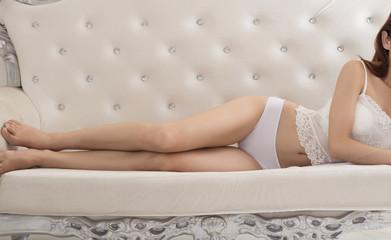 Underwear girl lying in sofa