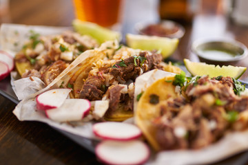 Wall Mural - three authentic mexican street tacos with barbacoa, carnitas and chicken