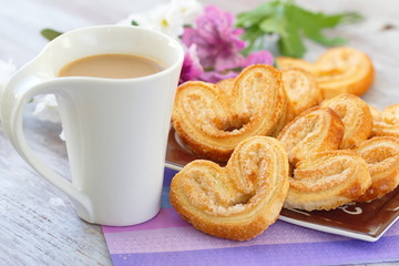 Cup of coffee and heart cookies