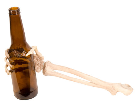 Skeleton hand and arm holding empty beer bottle on isolated white background