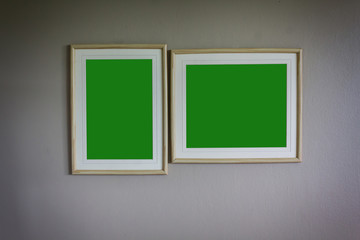green screen background of blank picture frame on classic wall