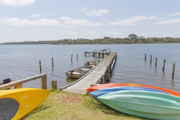 Colorful Canoes at the Jetty in the Blackwood River with Molloy Island on the Horizon on a sunny Day