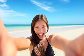 Selfie fun woman taking photo at beach vacation