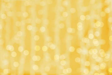blurred golden background with bokeh lights