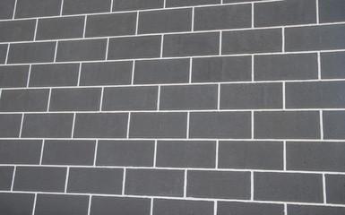 horizontal part of black painted brick wall