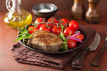 beef steak with spices and rosemary in plate
