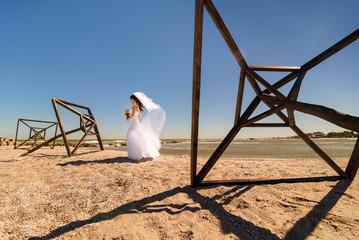 Bride at seaside