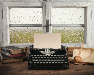 Antique typewriter with old window