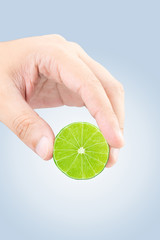 Male hand squeezing lime with clipping path