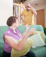 son and elderly mother during  quarrel