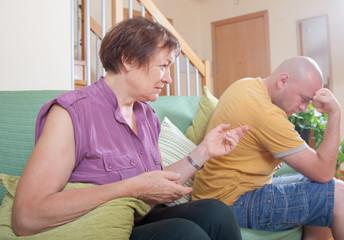 quarrel between an elderly mother and  son.
