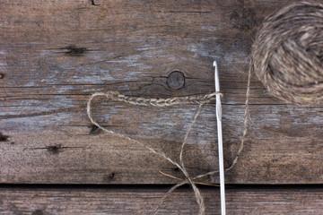 Skeins of wool yarn and crochet hook, loop. Rustic style