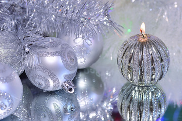 Christmas decorations with candle and silver balls.