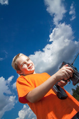 Little boy repaire the radio control car outdoor near field