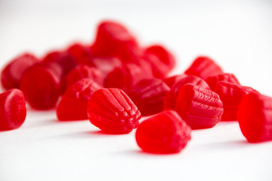 raspberry gummy in red on a white background