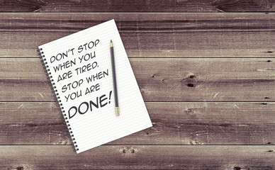 Inspirational quote on notepad.