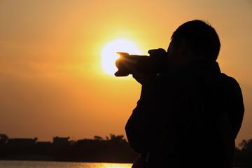 Photographer in dawn light