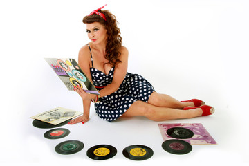 woman listening to vintage vinyl records