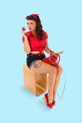 pin up girl relaxing, talking on the telephone