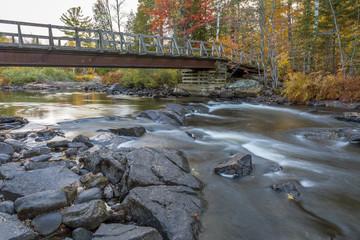 Bridge over an Autumn River
