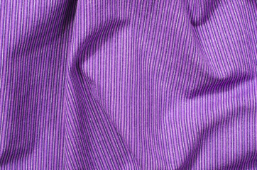 Striped purple textile pattern as a background. Close up on crumpled mauve material texture fabric.