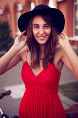 Beautiful smiling girl in hat urban portrait