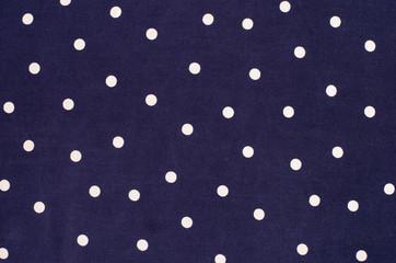 Polka dots pattern. White dots print on blue as background.