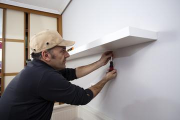Carpenter placing a shelf