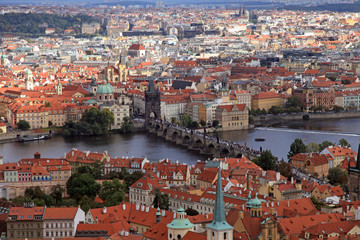 Panorama of Prague Old Town with red roofs and Vltava river