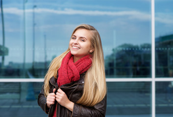 Smiling young woman with wool scarf