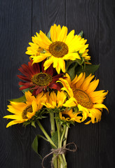 Sunflowers on a black wooden background