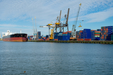 Loading/unloading shipping containers in the port of Rotterdam, Netherlands.
