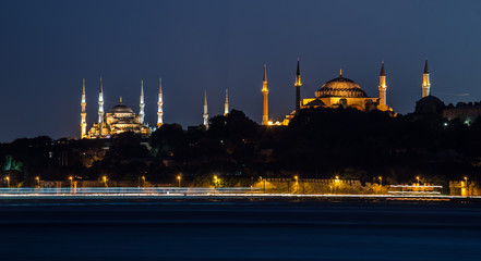 View over illuminated blue mosque and hagia sophia from opposite side of istanbul.