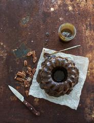 Chocolate coffee bundt cake with salt caramel icing over grunge